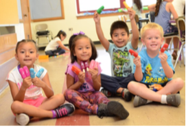 preschool children sitting and smiling