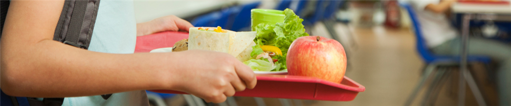 Photo of child carrying lunch tray in cafeteria